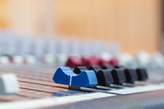 Closeup on sliders of sound mixing console in audio recording st Royalty Free Stock Images