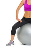 Closeup on slim woman sitting on fitness ball Royalty Free Stock Photography
