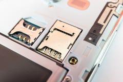 Closeup slot SIM card and slot memory micro SD card Royalty Free Stock Image