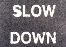 Closeup slow down marking on street, for warning the drivers to Royalty Free Stock Image