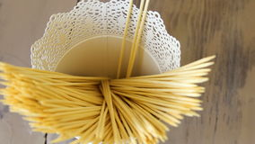 Closeup slow motion of human hand put wooden sticks for food and canape in bucket. Kitchen indoors stock footage