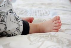 Closeup small baby feet, love concept. stock photos