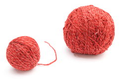 Closeup of small and big red wool ball. White background Stock Photos
