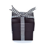 Black gift box with checkered ribbon Royalty Free Stock Photo