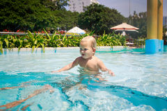 closeup small blonde girl stands in hotel swimming pool smiles Royalty Free Stock Photos