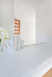 Closeup of a small book shelf on the empty white table decorated Royalty Free Stock Photography