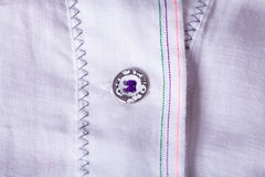 Closeup Small Buttons on White Cloth Royalty Free Stock Photography