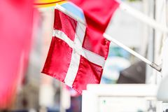 Closeup of small Denmark national flag. Patriotic danish symbols concept. Closeup of small Denmark national red and white flag Stock Photos