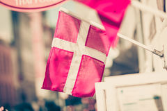 Closeup of small Denmark national flag. Patriotic danish symbols concept. Closeup of small Denmark national red and white flag Royalty Free Stock Photography