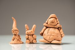 Small figurines made of clay by a child. Closeup of small figurines made of clay by a child royalty free stock photo