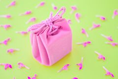 Closeup of a small gift wrapped with pink ribbon. Small gift box. Shallow depth of field. Flat lay, top view. royalty free stock photos