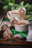 Small gingerbread cottages with hot chocolate in Christmas winter evening Royalty Free Stock Photo