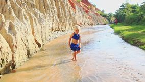 Closeup Small Girl Runs Plays in Stream Shallow Water stock footage