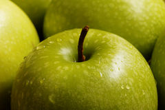 Closeup small green apple Stock Images