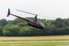 Closeup of Small Helicopter on Takeoff Stock Photography