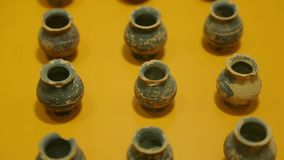 Closeup of small hemlock pots exhibited at archeology museum of Agora in Athens. Stock footage stock footage