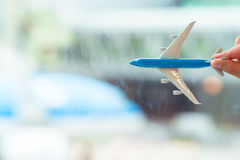 Closeup small miniature airplane at airport indoor Royalty Free Stock Photos
