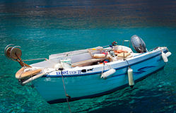 Closeup of small motorboat at clear water bay of Loutro town on Crete island, Greece Stock Photos