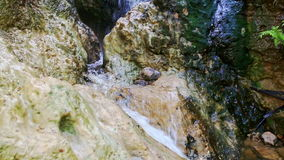 Closeup Small Mountain Waterfall Cascade among Stones stock footage