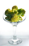 Closeup of small piece of broccoli on white Royalty Free Stock Photography
