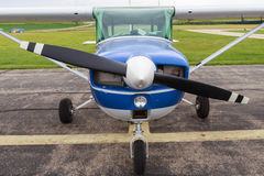 Closeup Small Private Airplane. A small private airplane front nose, landing gear, and propeller Royalty Free Stock Photo