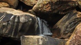 Closeup Small River Waterfall among Rocks. Closeup small rocky mountain river waterfall under sunlight stock video footage