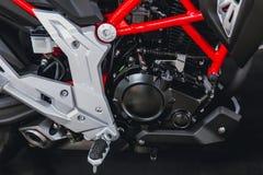 Motobike or motorcycle engine. Closeup small sport racing modern motobike or motorcycle engine Stock Image