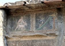 Closeup small tile mosaics, house in Parco Archeologico di Ercolano. Pictured is a closeup view of small tile mosaics in a house in the Parco Archeologico di Royalty Free Stock Image