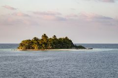 Closeup of a small tropical island at sunset Stock Image