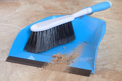 Closeup of a Small Whisk Broom with Short Handle and a Dustpan with Real Dirt Swept off Floor Stock Images