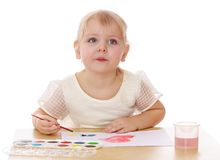 Closeup of a smart little girl draws paint sitting Stock Photo
