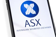 Closeup smartphone with ASX logo on the screen royalty free stock photos