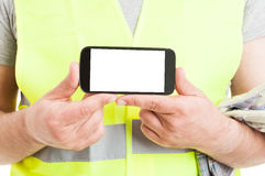 Closeup of smartphone in builder hands Royalty Free Stock Photography