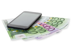 Closeup Of Smartphone On Euro Notes Royalty Free Stock Photography