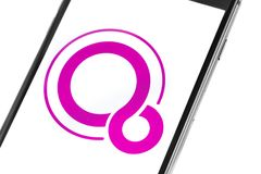 Closeup of smartphone screen with Google Fuchsia logo. Ekaterinb Royalty Free Stock Photos