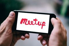 Closeup of smartphone screen with MEETUP LOGO and ICON