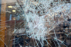 Closeup of smashed glass panel cracked Royalty Free Stock Photography