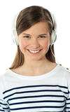 Closeup of a smiling beauty enjoying music Royalty Free Stock Photography
