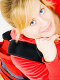 Closeup of smiling blond teenager with backpack Royalty Free Stock Photography