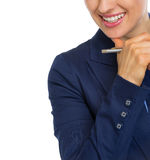 Closeup on smiling business woman with pen Royalty Free Stock Images