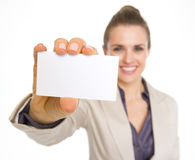 Closeup on smiling business woman showing business card Stock Image