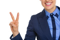 Closeup on smiling business woman showing victory Royalty Free Stock Image