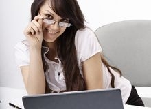 Closeup.smiling business woman sitting at a Desk. Photo with copy space Stock Photos