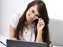 Closeup.smiling business woman sitting at a Desk. Photo with copy space Stock Photo