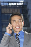 Closeup Of Smiling Businessman Using Cellphone Royalty Free Stock Photos