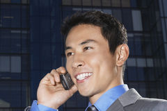 Closeup Of Smiling Businessman Using Cellphone Royalty Free Stock Photography