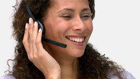 Closeup of a smiling businesswoman talking with headphones stock video