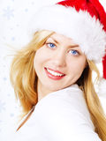 Closeup of smiling christmas woman over snow Royalty Free Stock Image