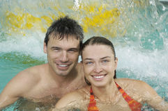 Closeup Of Smiling Couple In Swimming Pool Stock Photo