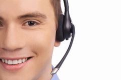 Closeup of smiling customer service agent with headset. Stock Image